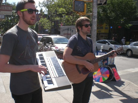 Observe as these hipster sidewalk band members sheild their delicate corneas from the powerful rays of the sun.